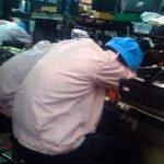 Workers sleeping in office factory